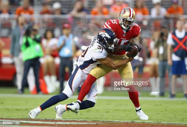Pierre Garcon of the San Francisco 49ers is tackled by Justin Simmons of the Denver Broncos at Levi's Stadium on August 19 2017 in Santa Clara...