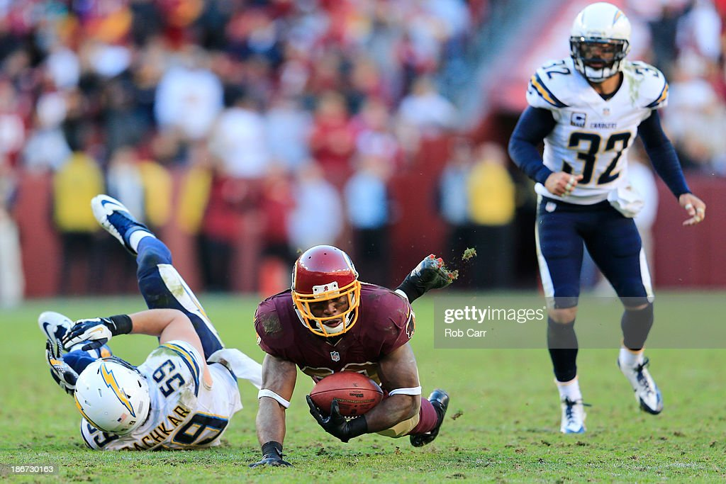<a gi-track='captionPersonalityLinkClicked' href=/galleries/search?phrase=Pierre+Garcon&family=editorial&specificpeople=4949132 ng-click='$event.stopPropagation()'>Pierre Garcon</a> #88 of the Washington Redskins catches a pass in front <a gi-track='captionPersonalityLinkClicked' href=/galleries/search?phrase=Andrew+Gachkar&family=editorial&specificpeople=6235135 ng-click='$event.stopPropagation()'>Andrew Gachkar</a> #59 of the San Diego Chargers during overtime of the Redskins 30-24 win at FedExField on November 3, 2013 in Landover, Maryland.