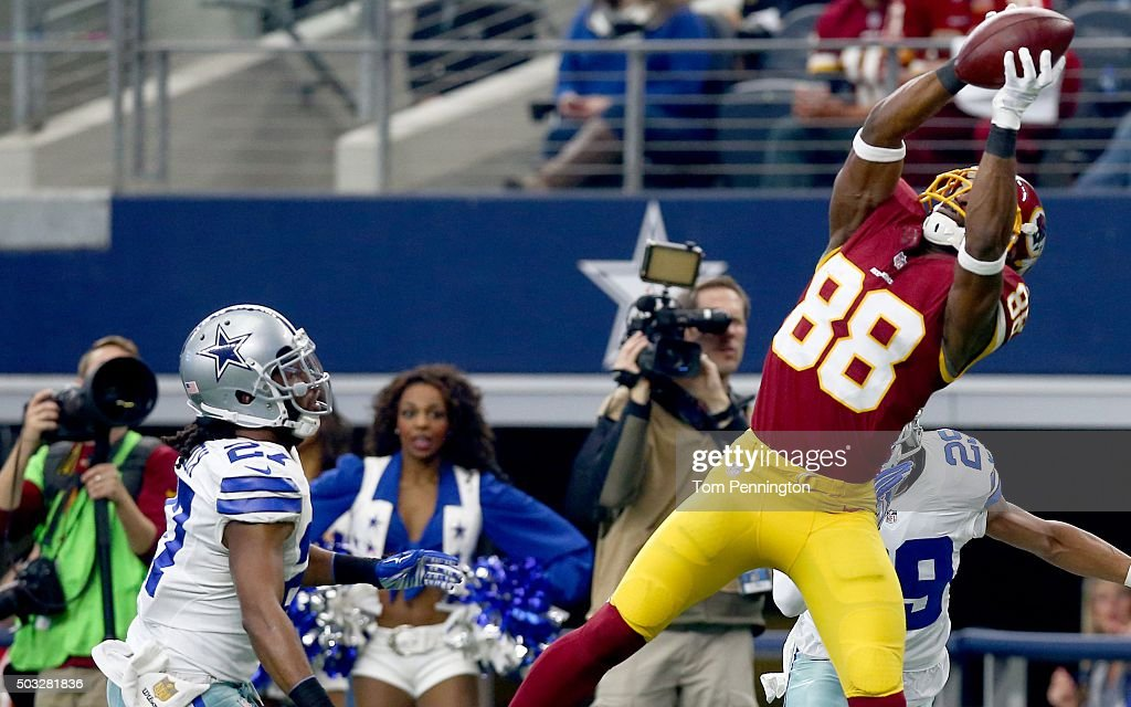 Pierre Garcon of the Washington Redskins catches a touchdown pass against JJ Wilcox of the Dallas Cowboys during the first half at ATT Stadium on...