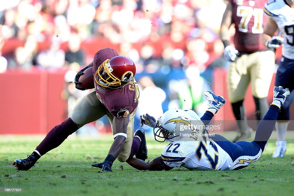 Pierre Garcon #88 of the Washington Redskins is tackled by Derek Cox #22 of the San Diego Chargers in the second quarter during an NFL game at FedExField on November 3, 2013 in Landover, Maryland.
