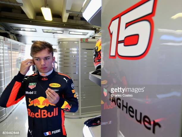 Pierre Gasly of France and Red Bull Racing prepares to drive in the garage during day two of F1 in season testing at Hungaroring on August 2 2017 in...