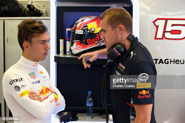 Pierre Gasly of France and Red Bull Racing talks to engineers in the garage during day two of F1 in season testing at Hungaroring on August 2 2017 in...