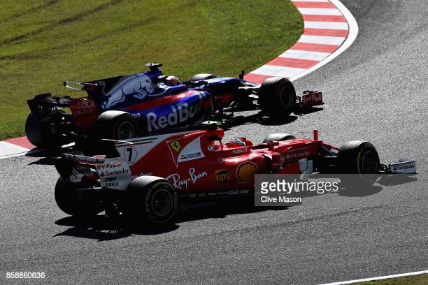 Pierre Gasly of France and Scuderia Toro Rosso drives in the Scuderia Toro Rosso STR12 leads Kimi Raikkonen of Finland driving the Scuderia Ferrari...
