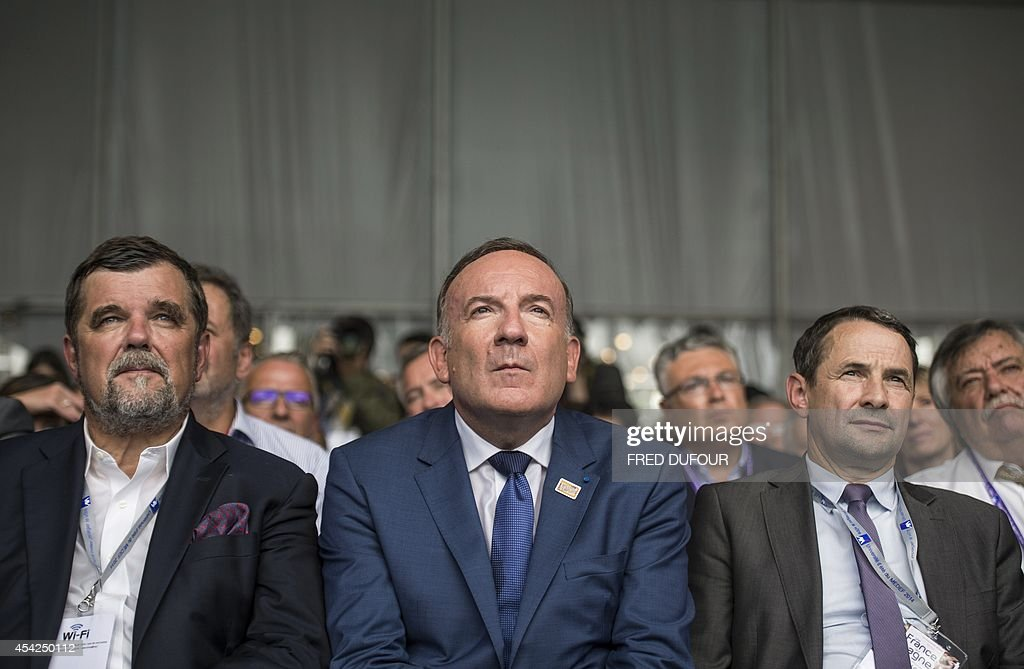 Pierre Gattaz (C), president of the French employers' association Medef, Pierre-Antoine Gailly (L), president of the Paris Chamber of Commerce and Industry (CCIP), and Junior minister for State reform Thierry Mandon (R), listens to French Prime minister's speech at the Medef summer conference on August 27, 2014 in Jouy-en-Josas, southwest of Paris. Gattaz on August 27 called on France's new government to 'dare reforms'.