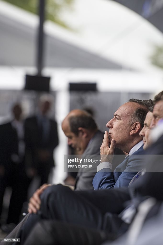 Pierre Gattaz (C), president of the French employers' association Medef listens to French prime minister's speech at the Medef summer conference on August 27, 2014 in Jouy-en-Josas, southwest of Paris. Gattaz on August 27 called on France's new government to 'dare reforms'.