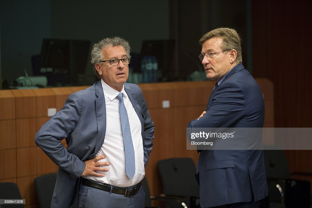 Pierre Gramegna, Luxembourg's finance minister, left, speaks with Johan Van Overtveldt, Belgium's finance minister, during a Eurogroup meeting of European finance ministers in Brussels, Belgium, on Tuesday, May 24, 2016. Five years after handing Greece the biggest sovereign-debt write-off in history, European policy makers have come full circle to the point they had all hoped to avoid: a real discussion on debt relief. Photographer: Jasper Juinen/Bloomberg via Getty Images