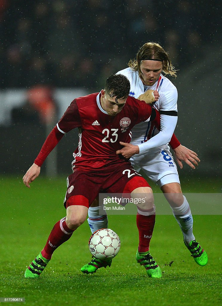 Pierre Hojbjerg of Denmark holds off Birkir Bjarnason of Iceland during the International Friendly match between Denmark and Iceland at the MCH Arena on March 24, 2016 in Herning, Denmark.
