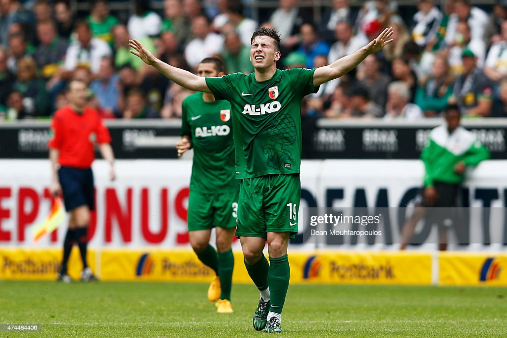 Pierre Hojbjerg of FC Augsburg celebrates scoring his teams first goal of the game during the Bundesliga match between Borussia Moenchengladbach and FC Augsburg held at Borussia Park Stadium on May 23, 2015 in Moenchengladbach, Germany.