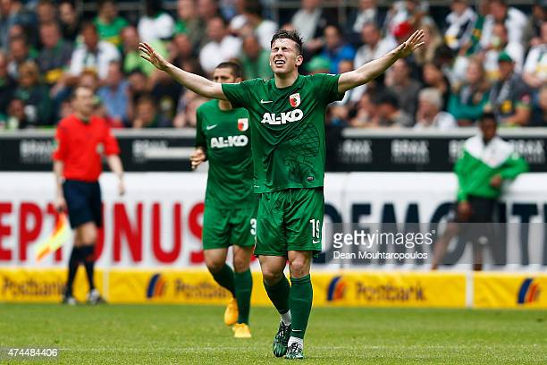 Pierre Hojbjerg of FC Augsburg celebrates scoring his teams first goal of the game during the Bundesliga match between Borussia Moenchengladbach and...