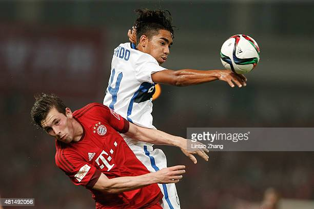 Pierre Hojbjerg of FC Internazionale challenges Pedro Delgado of FC Bayern Muenchen during the international friendly match between FC Bayern...