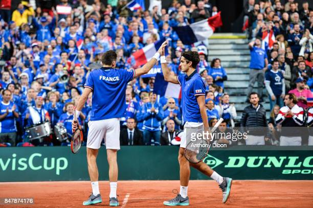 Pierre Hugues Herbert and Nicolas Mahut of France celebrates during the day 2 of the Semifinals of the Davis Cup between France and Serbia at Stade...