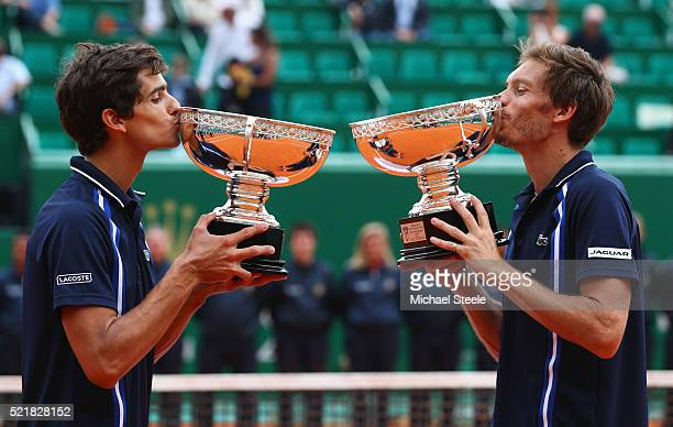 Pierre Hugues Herbert of France and Nicolas Mahut of France kiss their trophies after victory in the doubles final match against Jamie Murray of...