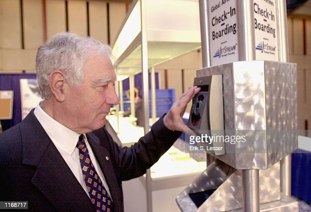 CEO Pierre J Jeanniot of Switzerland demonstrates a new eye recognition device called EyeTicket October 17 2001 at the IATA's AVSEC 2001 Symposium in...