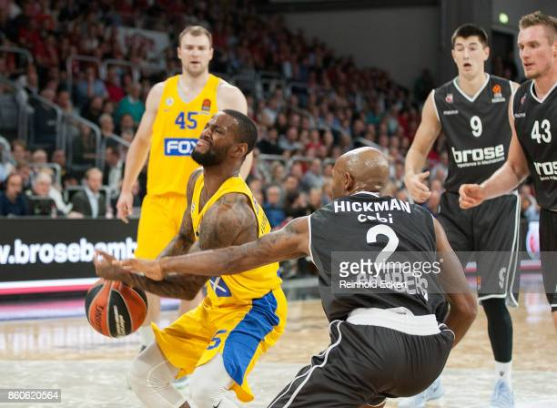 Pierre Jackson #55 of Maccabi Fox Tel Aviv competes with competes with Ricky Hickman #2 of Brose Bamberg during the 2017/2018 Turkish Airlines...