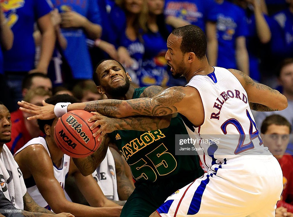 Pierre Jackson #55 of the Baylor Bears tries to control the ball as Travis Releford #24 of the Kansas Jayhawks defends during the game at Allen Fieldhouse on January 14, 2013 in Lawrence, Kansas.