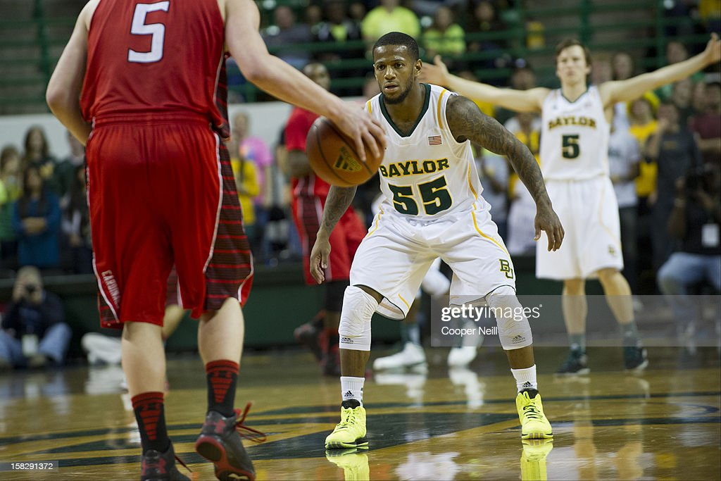 Pierre Jackson #55 of the Baylor University Bears defends against the Lamar Cardinals on December 12, 2012 at the Ferrell Center in Waco, Texas.