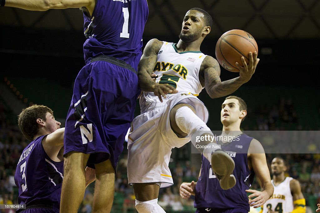 Pierre Jackson #55 of the Baylor University Bears drives to the basket against the Northwestern University Wildcats on December 4, 2012 at the Ferrell Center in Waco, Texas.