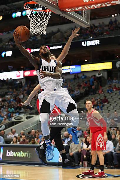 Pierre Jackson of the Dallas Mavericks drives to the basket against the Houston Rockets in the second half at American Airlines Center on December 27...
