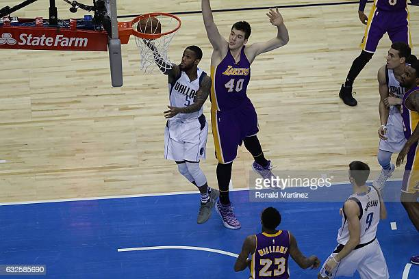 Pierre Jackson of the Dallas Mavericks takes a shot against Ivica Zubac of the Los Angeles Lakers at American Airlines Center on January 22 2017 in...
