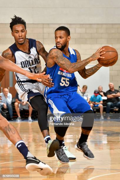 Pierre Jackson of the Detroit Pistons looks to pass the ball against the Dallas Mavericks during the Mountain Dew Orlando Pro Summer League...