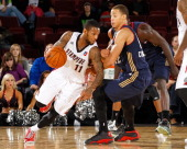 Pierre Jackson of the Idaho Stampede moves the ball against Jared Cunningham of the Bakersfield Jam during an NBA DLeague game on November 22 2013 at...