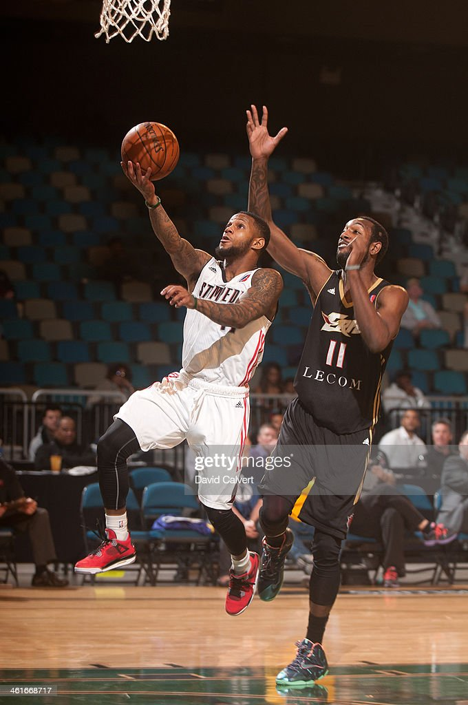 Pierre Jackson #11 of the Idaho Stampede shoots a layup ahead of defender CJ Leslie #11 of the Erie BayHawks during the 2014 NBA D-League Showcase on January 8, 2014 at the Reno Events Center in Reno, Nevada.