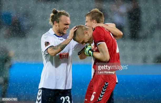 Pierre Kanstrup Frederik Moller and Goalkeeper Aleksandar Jovanovic of AGF Aarhus celebrate after the Danish Alka Superliga match between AGF Aarhus...