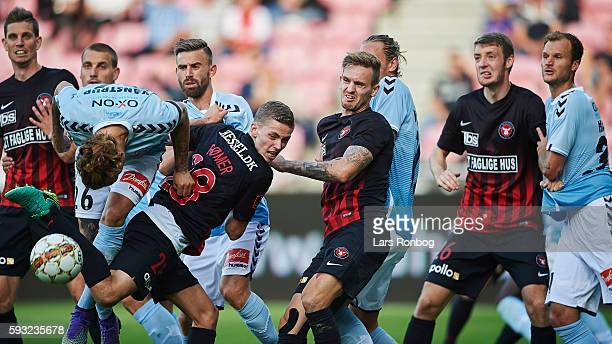 Pierre Kanstrup of Sonderjyske and Andre Romer of FC Midtjylland compete for the ball during the Danish Alka Superliga match between FC Midtjylland...