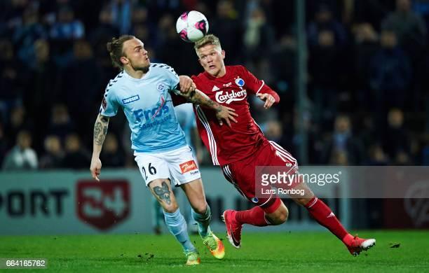 Pierre Kanstrup of Sonderjyske and Andreas Cornelius of FC Copenhagen compete for the ball during the Danish Alka Superliga match between Sonderjyske...