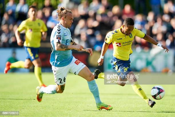 Pierre Kanstrup of SonderjyskE and Kevin Mensah of Brondby IF compete for the ball during the Danish Alka Superliga match between SonderjyskE and...