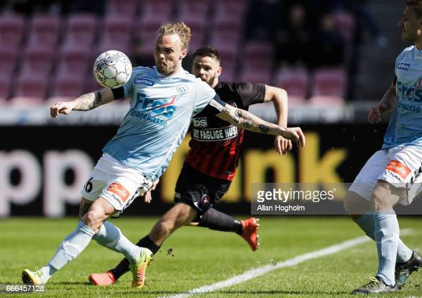 Pierre Kanstrup of SonderjyskE and Marc Dal Hende of FC Midtjylland compete for the ball during the Danish Alka Superliga match between FC...