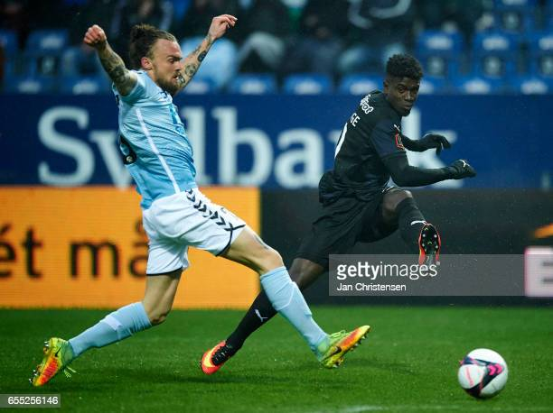 Pierre Kanstrup of SonderjyskE and Mayron George of Randers FC compete for the ball during the Danish Alka Superliga match between SonderjyskE and...