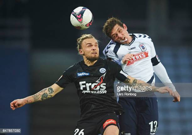 Pierre Kanstrup of Sonderjyske and Morten Duncan Rasmussen head coach of AGF Aarhus compete for the ball during the Danish Alka Superliga match...
