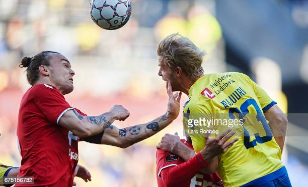 Pierre Kanstrup of Sonderjyske and Paulus Arajuuri of Brondby IF compete for the ball during the Danish Alka Superliga match between Brondby IF and...