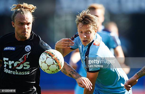 Pierre Kanstrup of Sonderjyske and Viktor Lundberg of Randers FC compete for the ball during the Danish Alka Superliga match between Randers FC and...