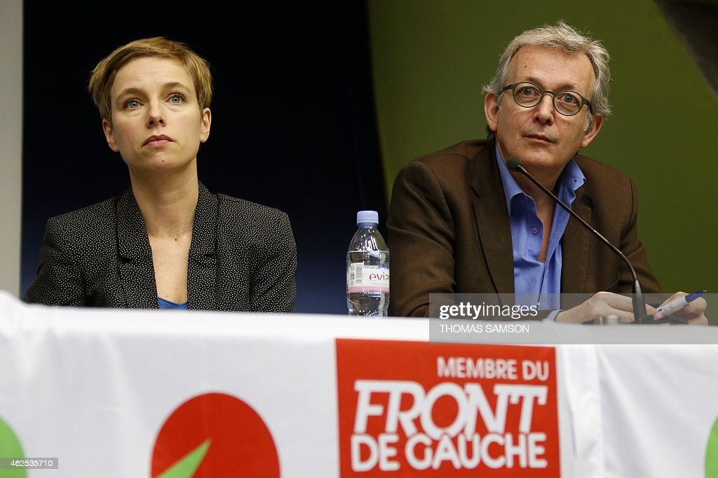 Pierre Laurent (R), head of the French Communist Party (PCF), and Clementine Autain, spokesperson of 'Ensemble', attend a meeting of the French political movement 'Ensemble' in Bobigny, near Paris, on January 30, 2015. AFP PHOTO / THOMAS SAMSON