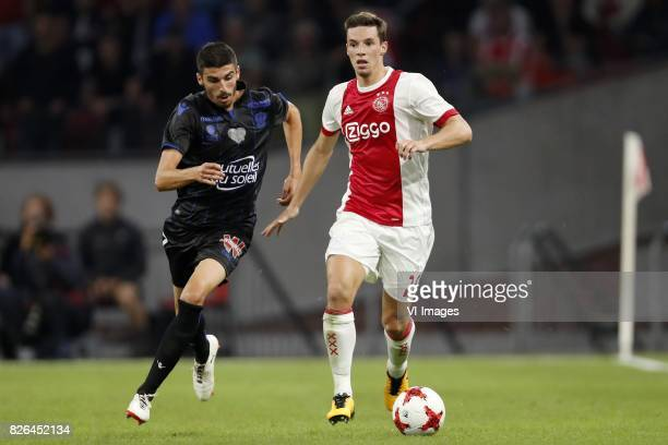 Pierre LeesMelou of OCG Nice Nick Viergever of Ajax during the UEFA Champions League third round qualifying first leg match between Ajax Amsterdam...