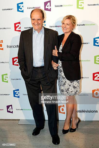 Pierre Lescure and AnneElisabeth Lemoine attend the 'Rentree De France Televisions' at Palais De Tokyo on August 26 2014 in Paris France