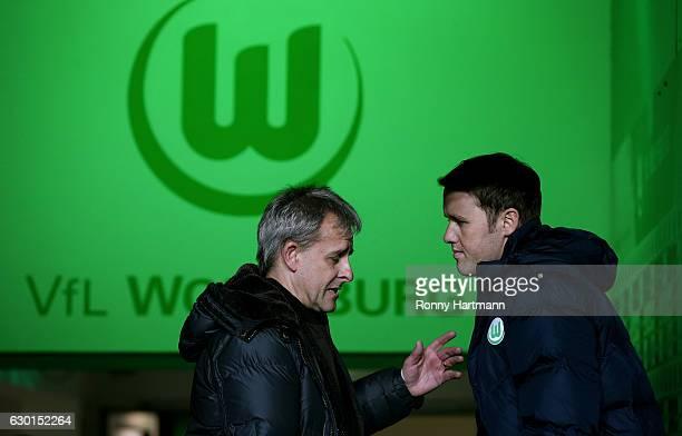 Pierre Littbarski chats with Olaf Rebbe sporting director of Wolfsburg prior to the Bundesliga match between VfL Wolfsburg and Eintracht Frankfurt at...