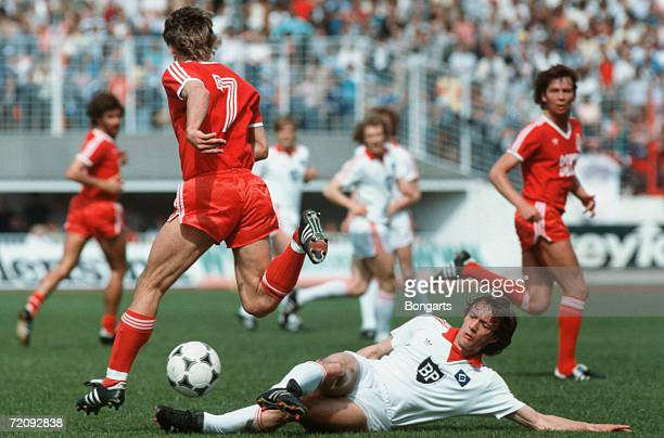 Pierre Littbarski of Cologne and Bernd Wehmeyer of Hamburg battle for the ball during the Bundesliga match between Hamburger SV and 1 FC Cologne at...