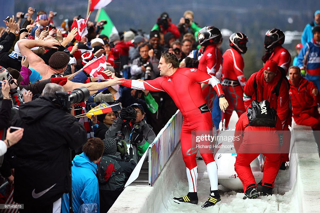 <a gi-track='captionPersonalityLinkClicked' href=/galleries/search?phrase=Pierre+Lueders&family=editorial&specificpeople=211058 ng-click='$event.stopPropagation()'>Pierre Lueders</a> of Canada 2 celebrates with fans after completing heat 4 during the men's four man bobsleigh on day 16 of the 2010 Vancouver Winter Olympics at the Whistler Sliding Centre on February 27, 2010 in Whistler, Canada.
