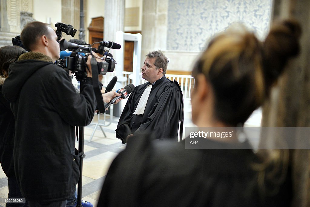 Pierre Lumbroso (C), counsel for Omar Top El Hadj, answers journalists' questions in Lyon's criminal court, on April 2, 2013, on the opening day of Christophe Khider and Omar Top El Hadj's trial. They are judged for having escaped from jail using explosives and taking hostages two prison staffs.