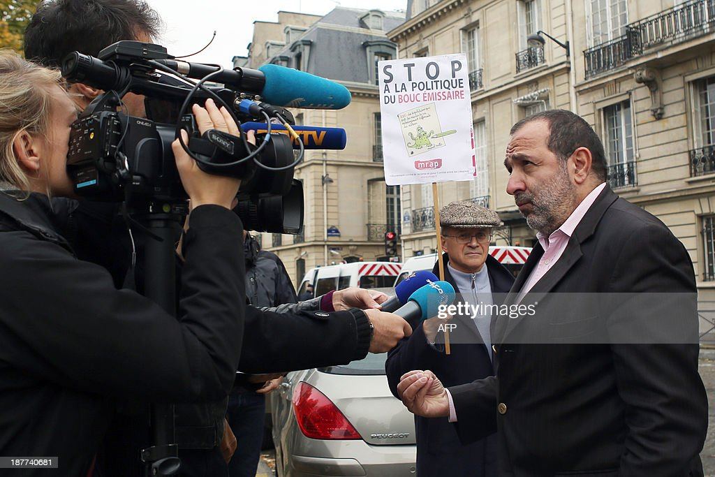 Pierre Mairat, lawyer of French anti-racist NGO MRAP (Movement Against Racism and for Friendship between Peoples) answers journalists' questions upon his arrival at the Law court of the Republic, on November 12, 2013 in Paris, prior to file a complaint against French Interior minister for provoking racial hatred. France's Interior Minister Manuel Valls provoked a row on September 24 when he said the lifestyle of Roma is in confrontation with French society.