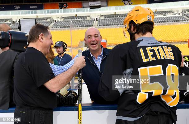 Pierre McGuire laughs with Jacques Martin and Kris Letang of the Pittsburgh Penguins at Heinz Field on February 24 2017 in Pittsburgh Pennsylvania