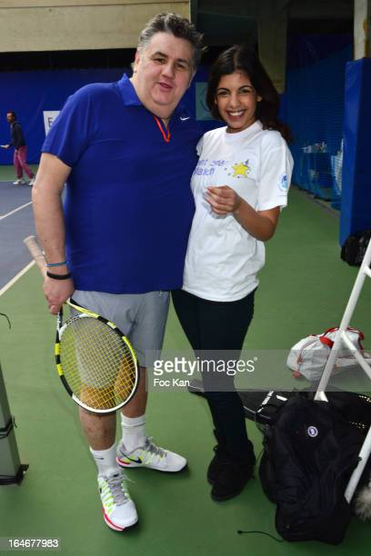 Pierre Menes and Donia Eden from the Journal du Hard attend the 'Enfant Star Match' Auction Cocktail At Tennis Club De Paris on March 25 2013 in...