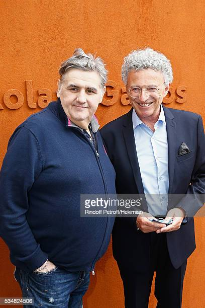 Pierre Menes and Nelson Montfort attend The French Tennis Open Day Seven at Roland Garros on May 28 2016 in Paris France