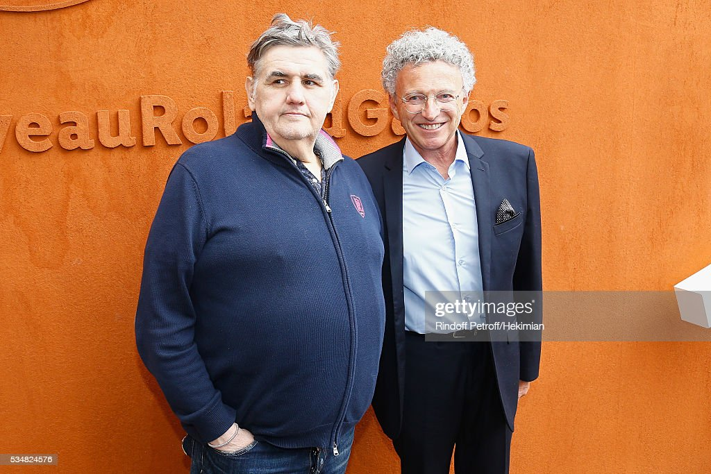 Pierre Menes (L) and Nelson Montfort attend The French Tennis Open Day Seven at Roland Garros on May 28, 2016 in Paris, France.