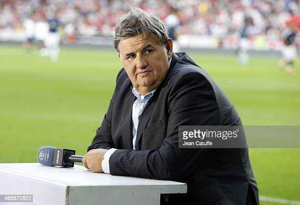 Pierre Menes of Canal Plus comments the French Ligue 1 match between Lille OSC and Paris SaintGermain at Grand Stade Pierre Mauroy on August 7 2015...