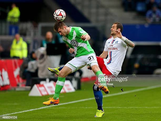 Pierre Michel Lasogga of Hamburg and Robin Knoche of Wolfsburg battle for the ball during the Bundesliga match between Hamburger SV and VfL Wolfsburg...