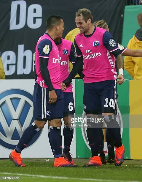 Pierre Michel Lasogga of Hamburg jubilates with team mate Bobby Wood after scoring the third goal during the DFB Cup second round match between...